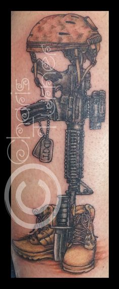 Helmet On Gun And Boot Tattoo