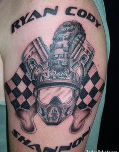 Helmet Pistons And Flag Tattoos On Biceps