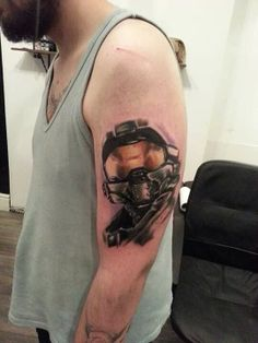 Helmet Tattoo On Muscles For Guys