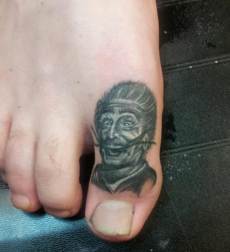 Hilarious Portrait Tattoo On Finger