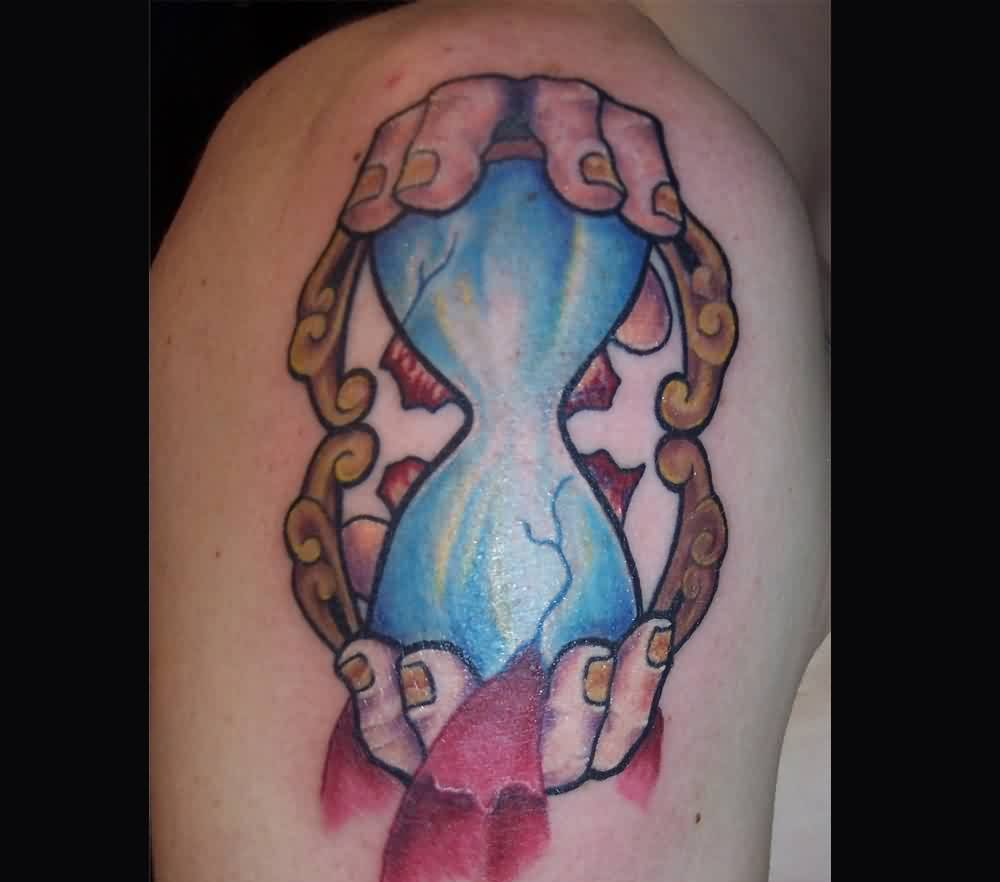 Hour Glass In Hand Tattoo