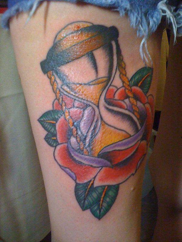 Hour Glass In Rose Tattoo