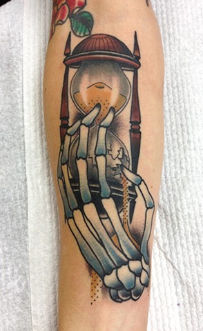 Hourglass In Skeleton Hand Tattoo