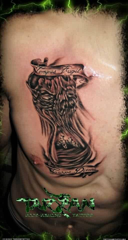 Hourglass Tarzan Tattoo On Chest For Men