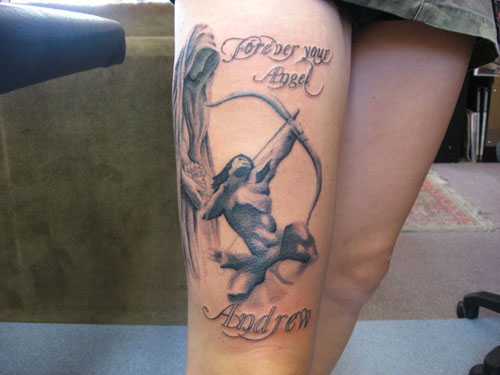 Hunter With Bow And Arrow Tattoo On Thigh