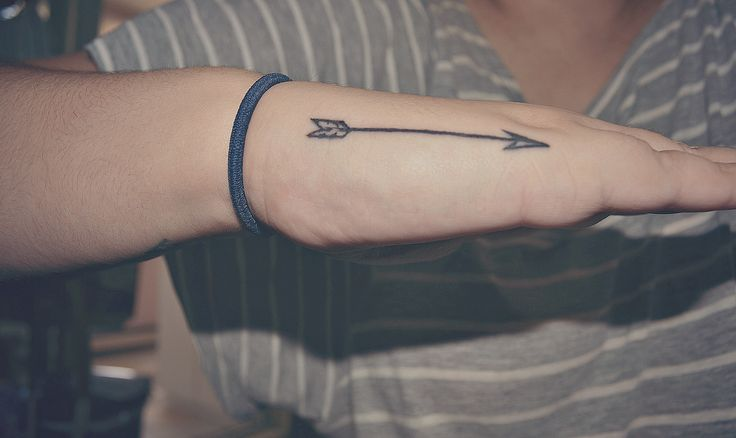 Impressive Black Arrow Tattoo On Hand