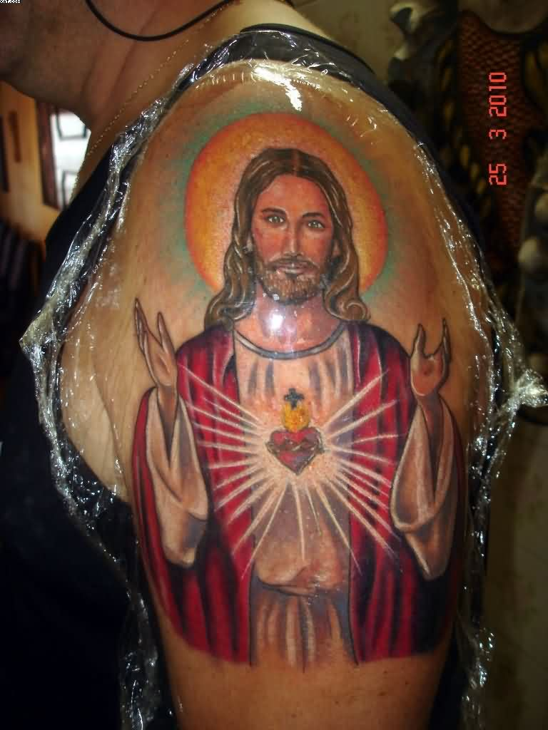 Impressive Jesus Portrait Tattoo On Upper Arm