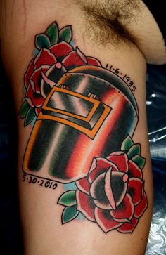 Impressive Welding Helmet Tattoo And Roses On Arm