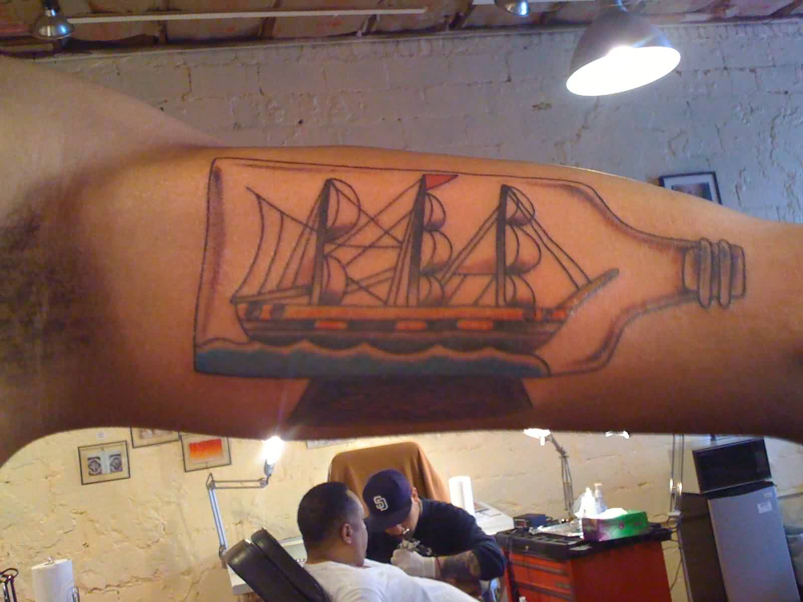 Inner Arm Bottle With Ship Tattoo (2)
