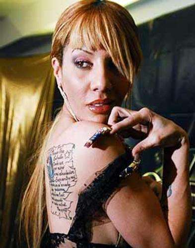 Ivy Queen Shows Off Her Tattoos
