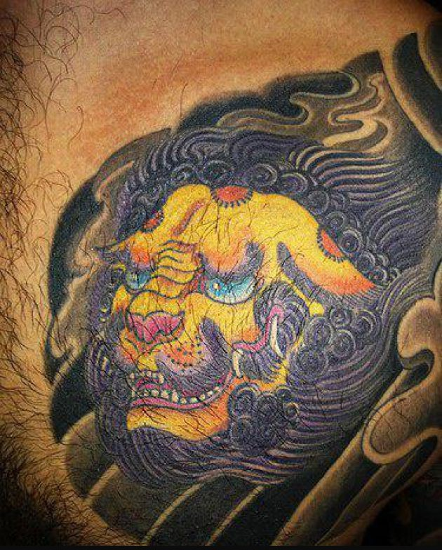 Japanese Yellow Lion Tattoo On Chest