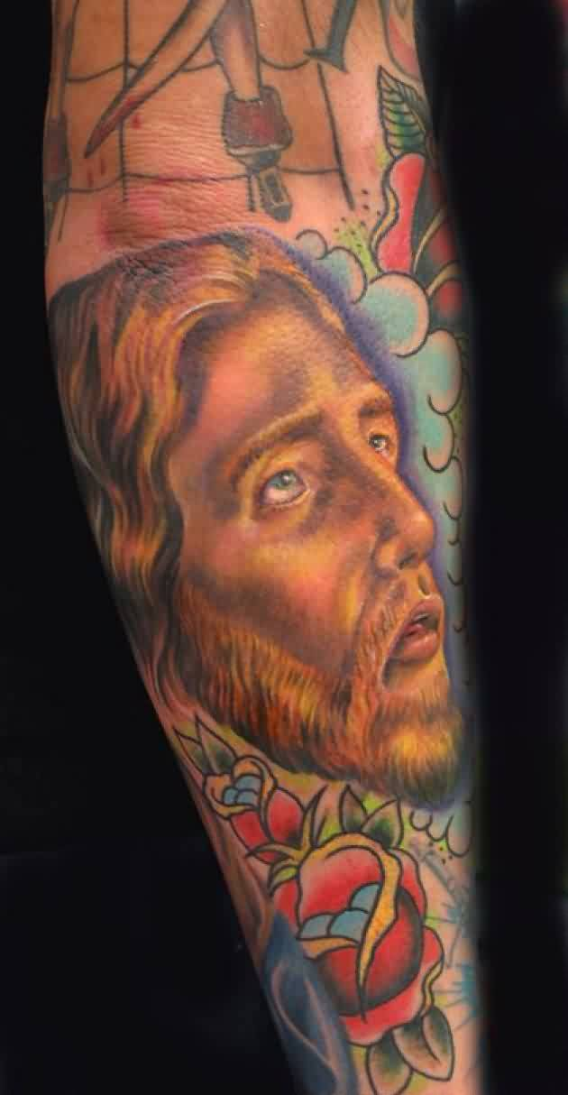Jesus Portrait And Rose Tattoos On Sleeve