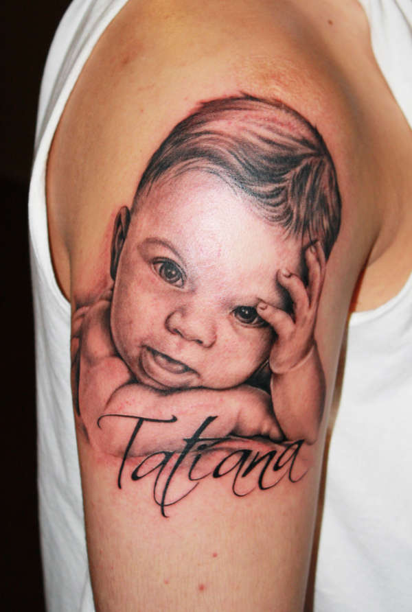 Kid Portrait With Name Tattoo On Arm