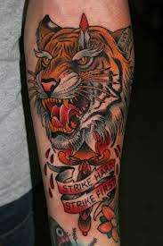 Knife Through Animal And Banner Tattoos