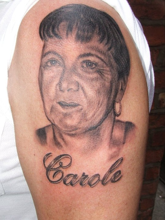 Lady Face Portrait And Name Tattoo On Biceps