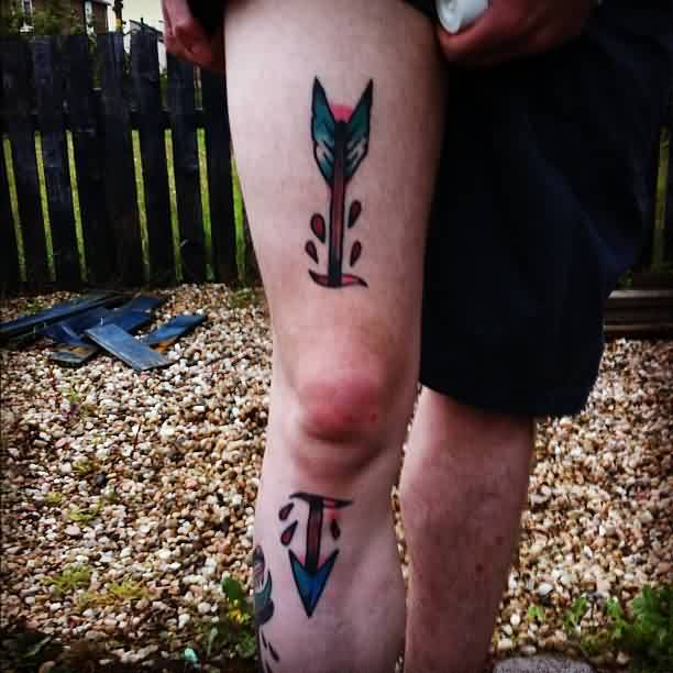 Large Arrow Through Knee Tattoo