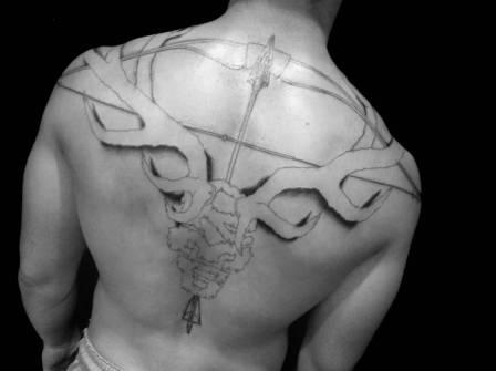 Large Bow And Arrow Tattoos On Backbody