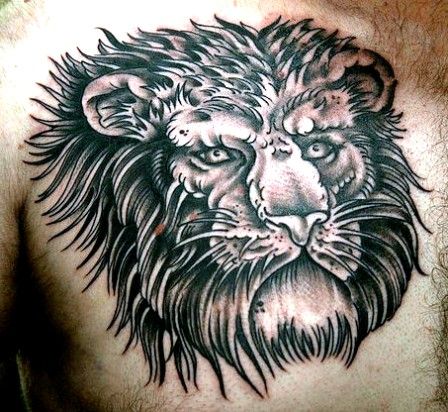 Large Lion Face Tattoo On Chest