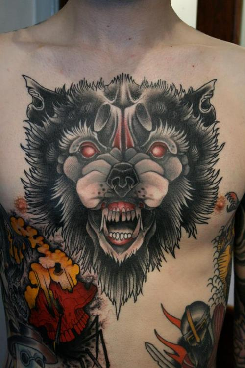 Large Red Eyed Animal Tattoo On Chest