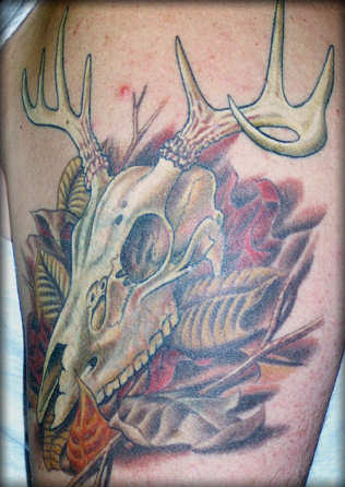 Leaves And Animal Skull Tattoos