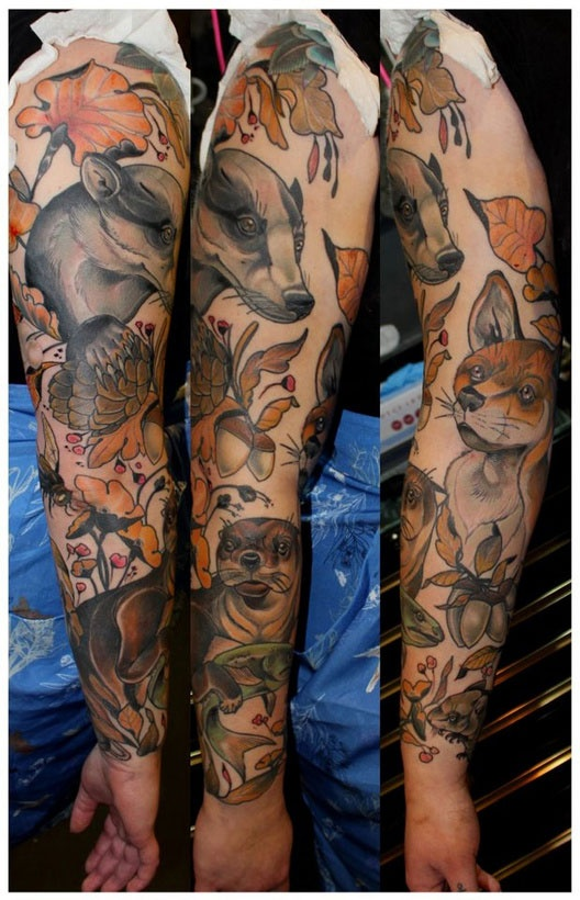 Leaves And Animal Tattoos On Sleeve