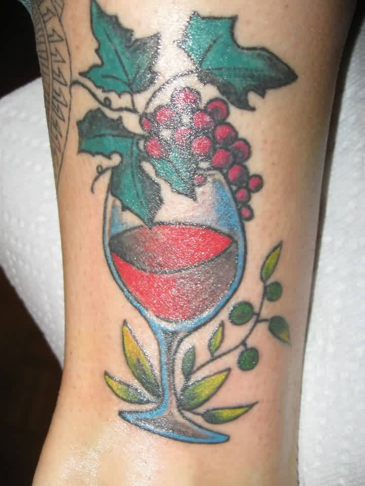 Leaves And Grapes On Wine Glass Tattoo