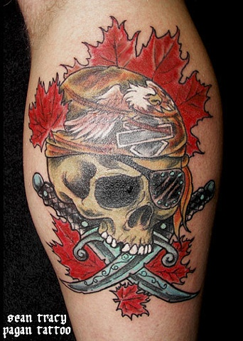 Leaves And Skull In Helmet And Crossed Knife Tattoo