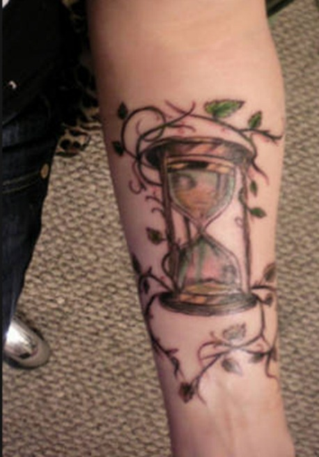 Leaves Vine And Hour Glass Tattoos On Forearm