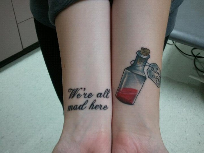 Lettering And Bottle Wrist Tattoos