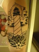 Lighthouse And Flower Tattoos On Arm