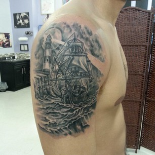 Lighthouse And Sailing Ship Tattoos On Shoulder