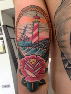 Lighthouse In Frame And Rose Tattoos