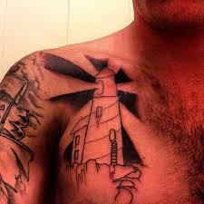 Lighthouse Tattoo On Left Side Of Chest