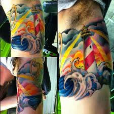 Lightning Lighthouse And Wave Tattoos On Muscles