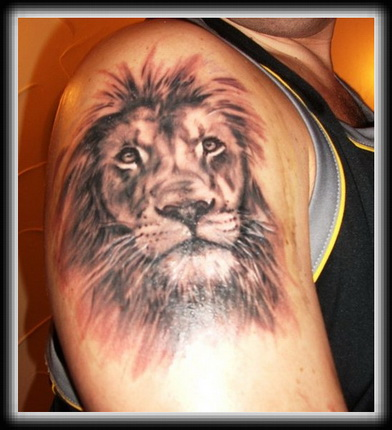 Lion Face Grey Ink Tattoo On Biceps