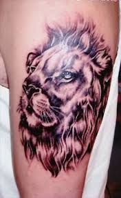 Lion Face Tattoo On Biceps