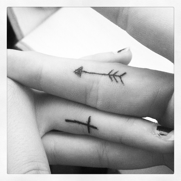 Little Arrow And Cross Tattoos On Fingers