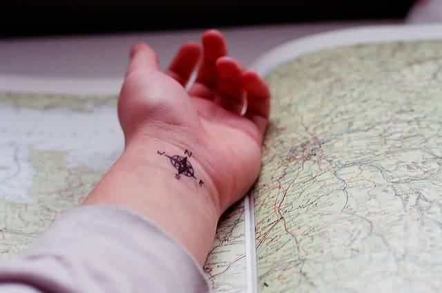 Little Arrow Compass Tattoo On Inner Wrist