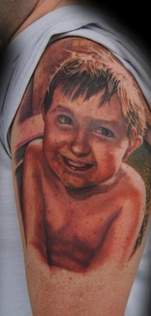 Little Boy Portrait Tattoo On Shoulder