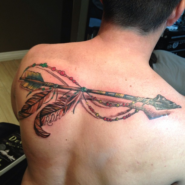 Long 3D Ancient Arrow With Feather Tattoo On Upperback
