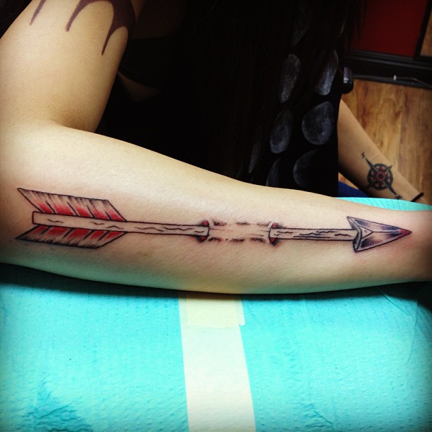 Long Arrow Through Skin Tattoo