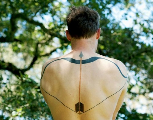 Long Arrow With Bow Tattoo On The Back