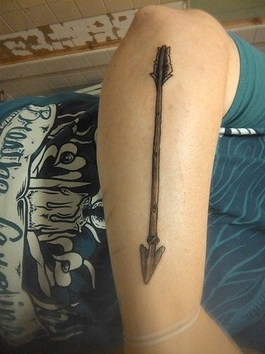 Long Old Grey Arrow Tattoo On Arm