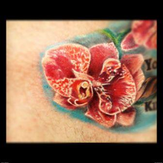 Lovely Red Orchid Portrait Tattoo