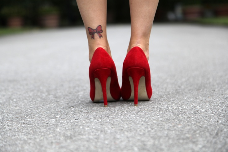 Lovely Red Ribbon Bow Tattoo On Left Leg