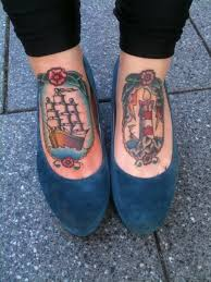 Lovely Ship And Lighthouse Tattoos On Feet