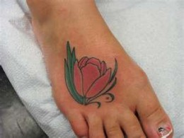 Lovely Tulip Tattoo On Foot For Women
