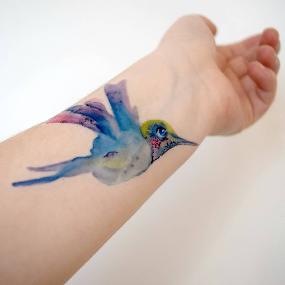 Lovely Watercolor Bird Tattoo On Wrist