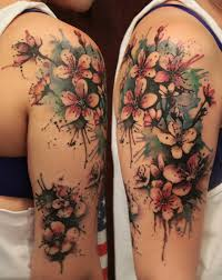 Lovely Watercolor Blossoms Tattoos On Arm