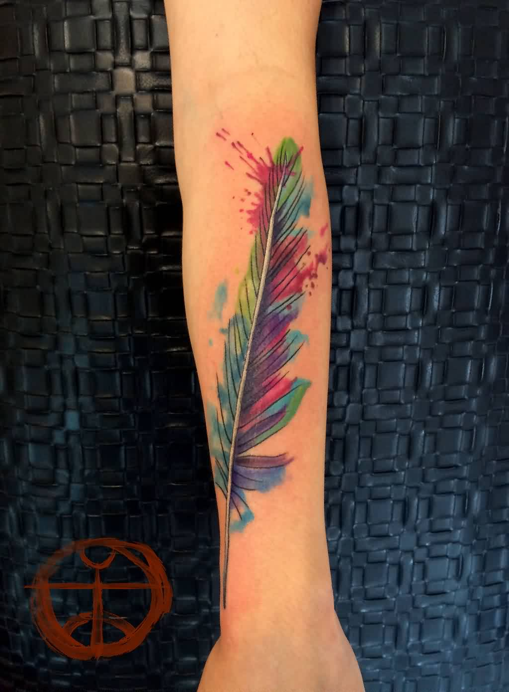Lovely Watercolor Feather Tattoo On Arm
